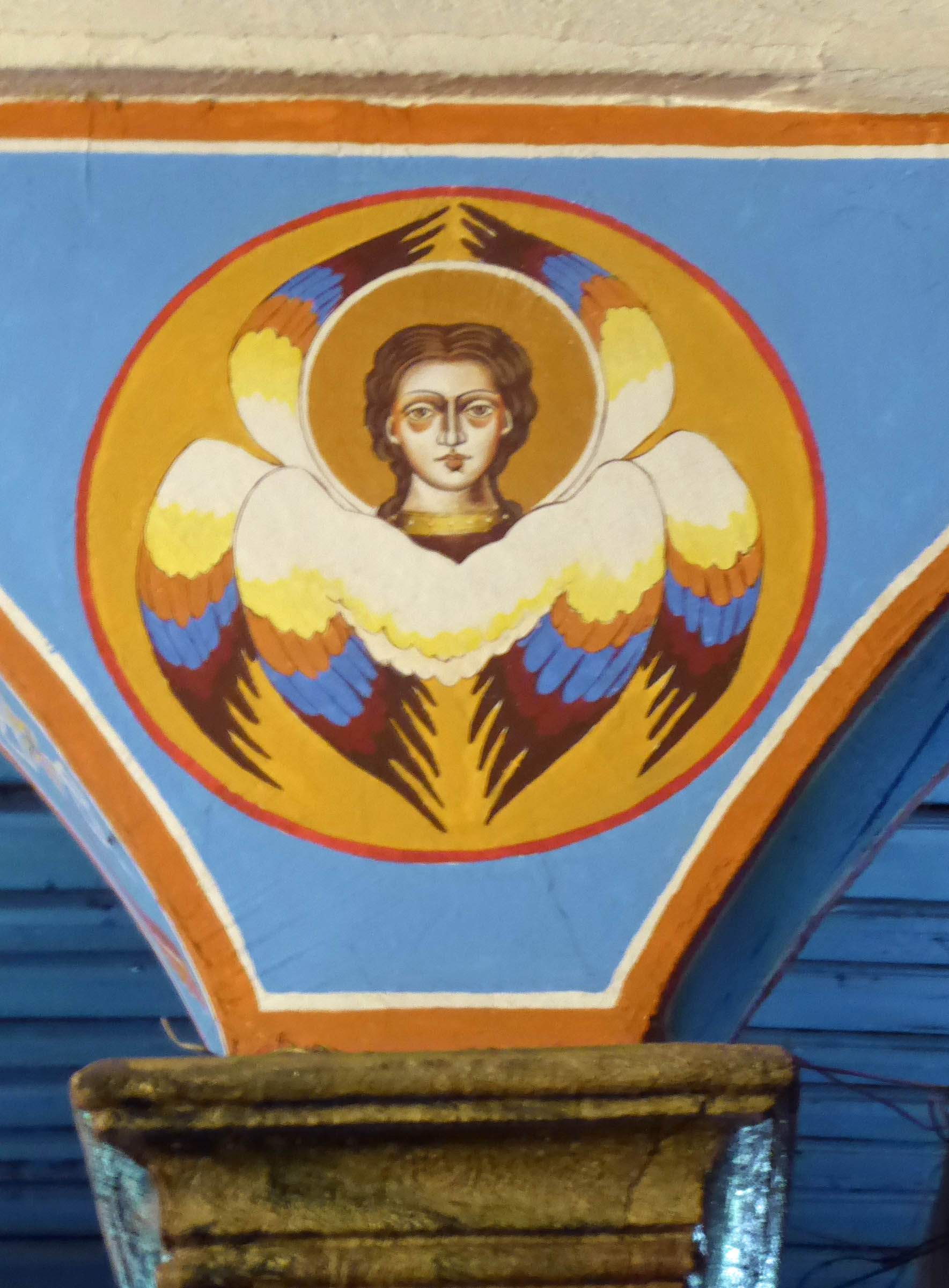 Painting of angel on blue wall