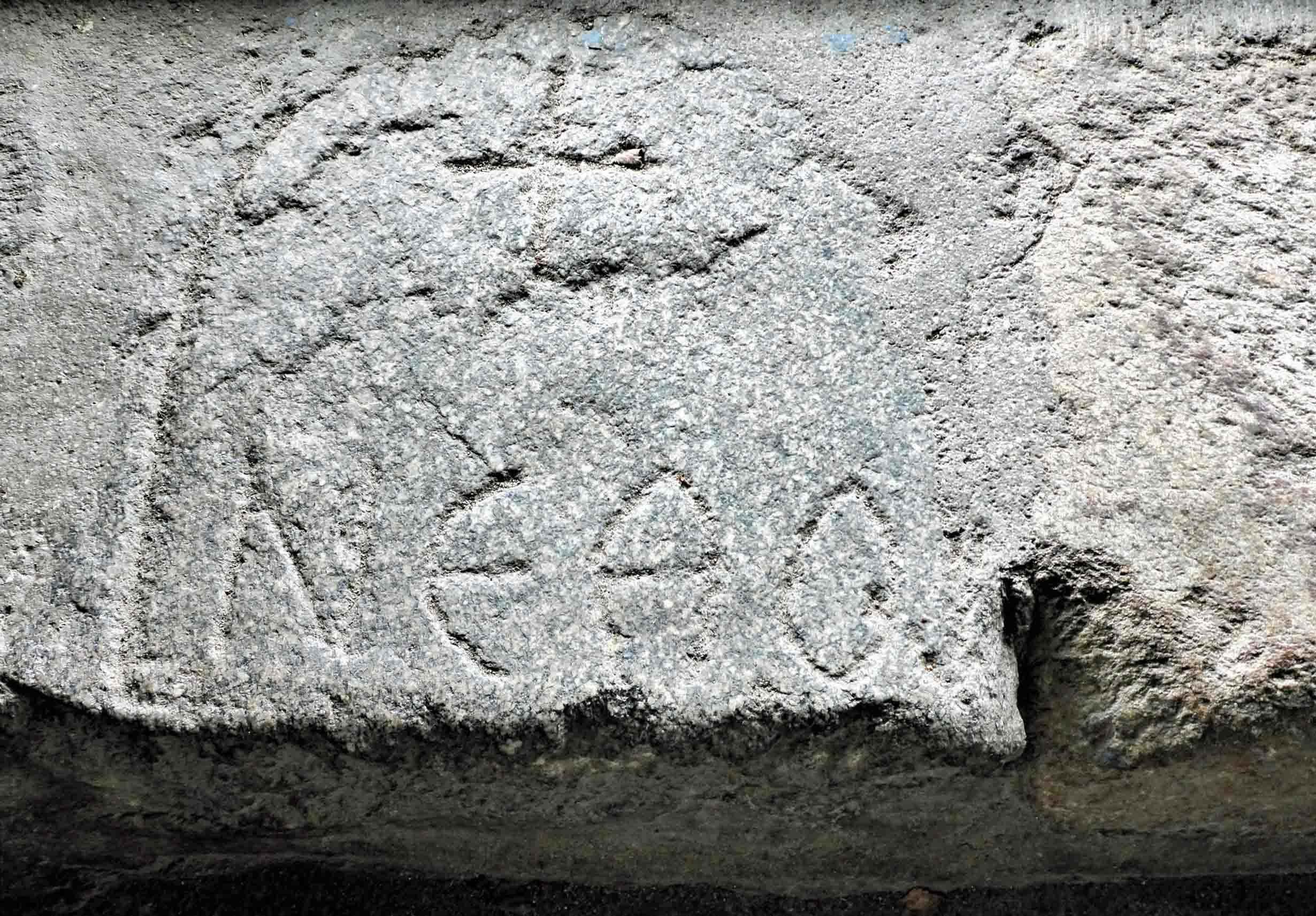 Stone carved with Greek letters
