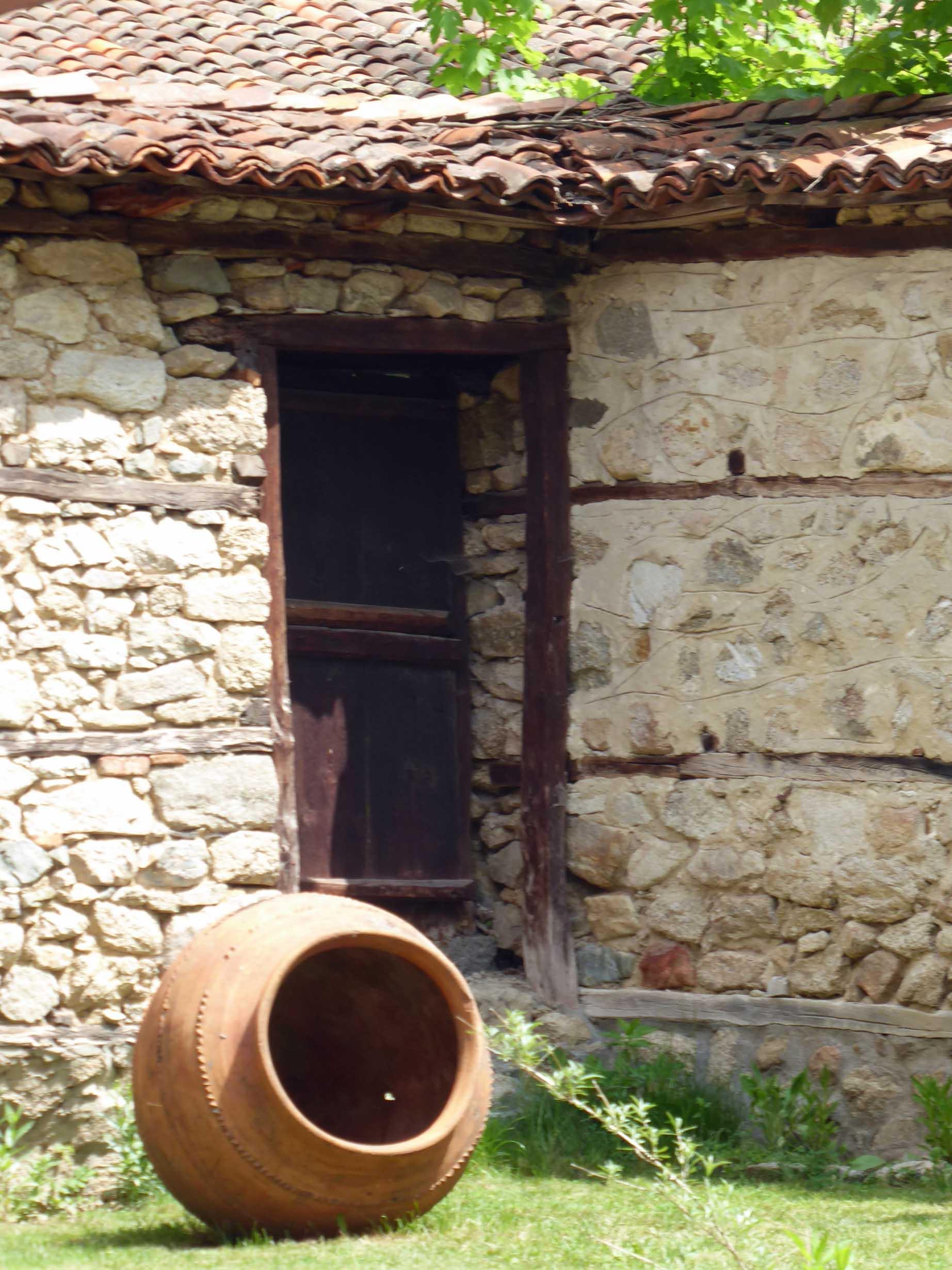 Stone wall and terracotta urn