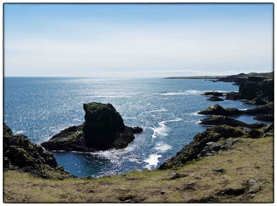 View from cliffs of rocky coastline