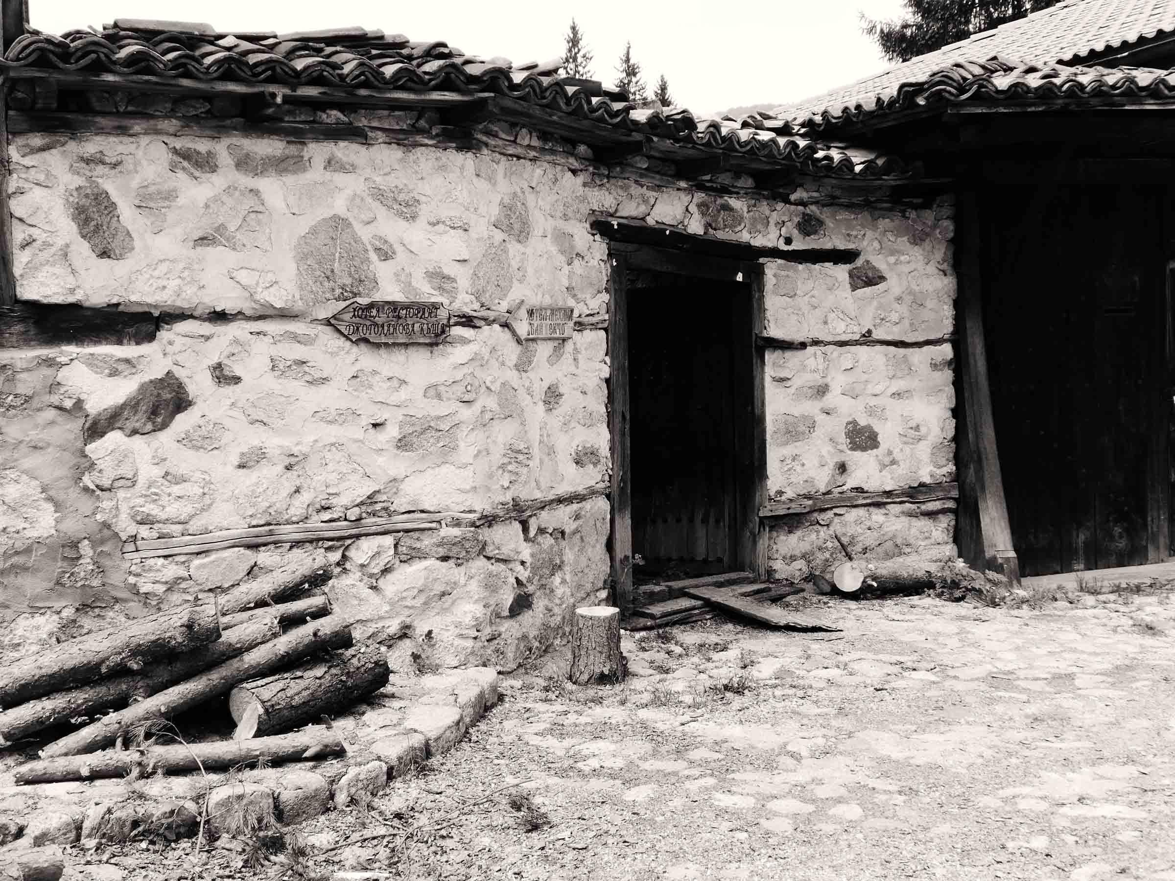 Sepia photo of small stone building