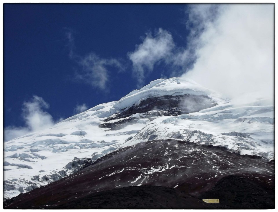 Snowy mountain and blue sky above