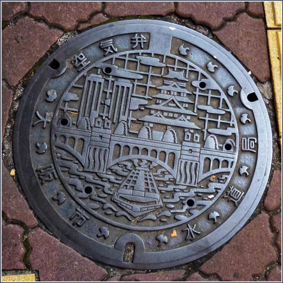 Ornate metal manhole cover