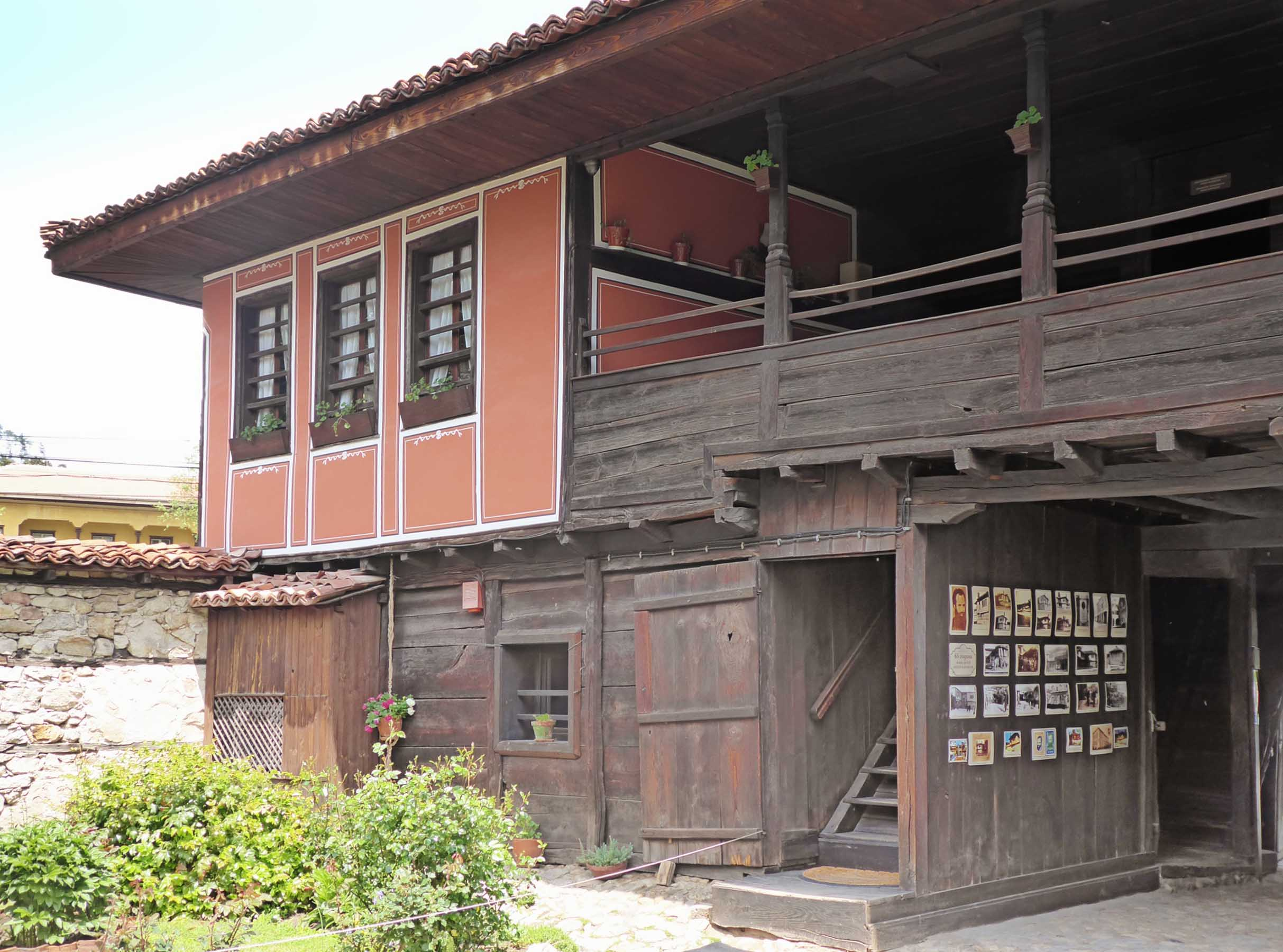 Wooden house with terracotta coloured painted walls