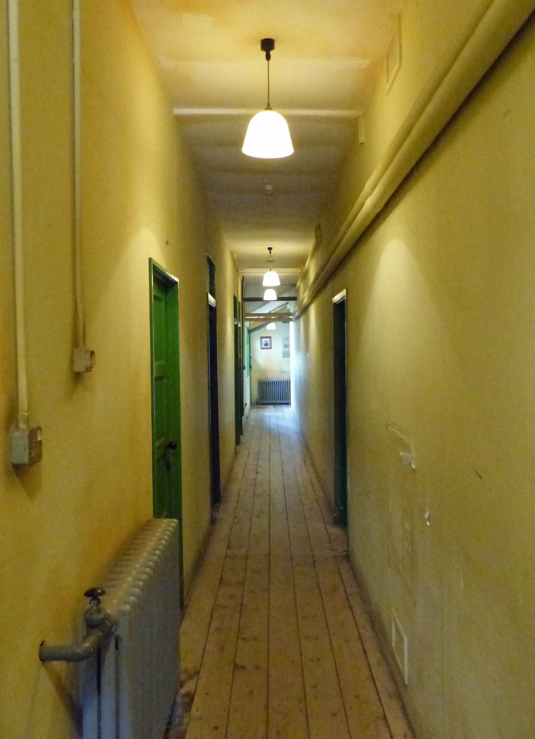 Narrow corridor with yellow walls