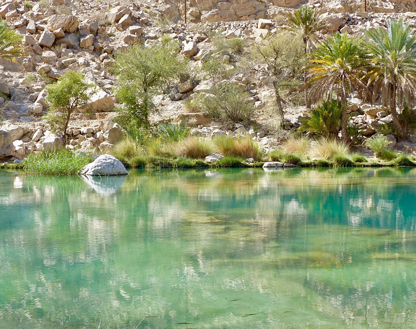 Green pool with rocky banks