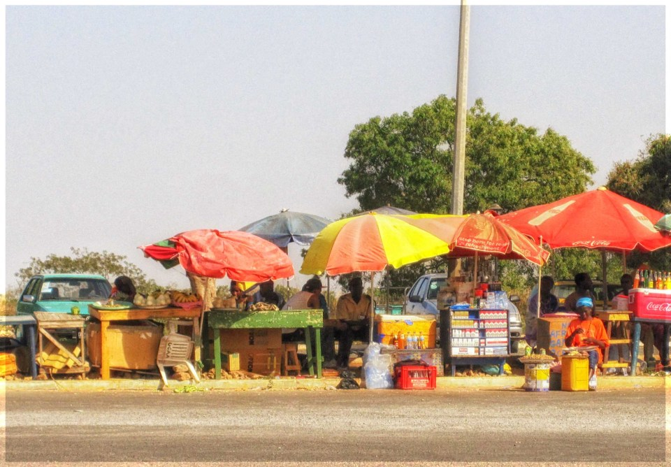 Small roadside stalls selling drinks and fruit
