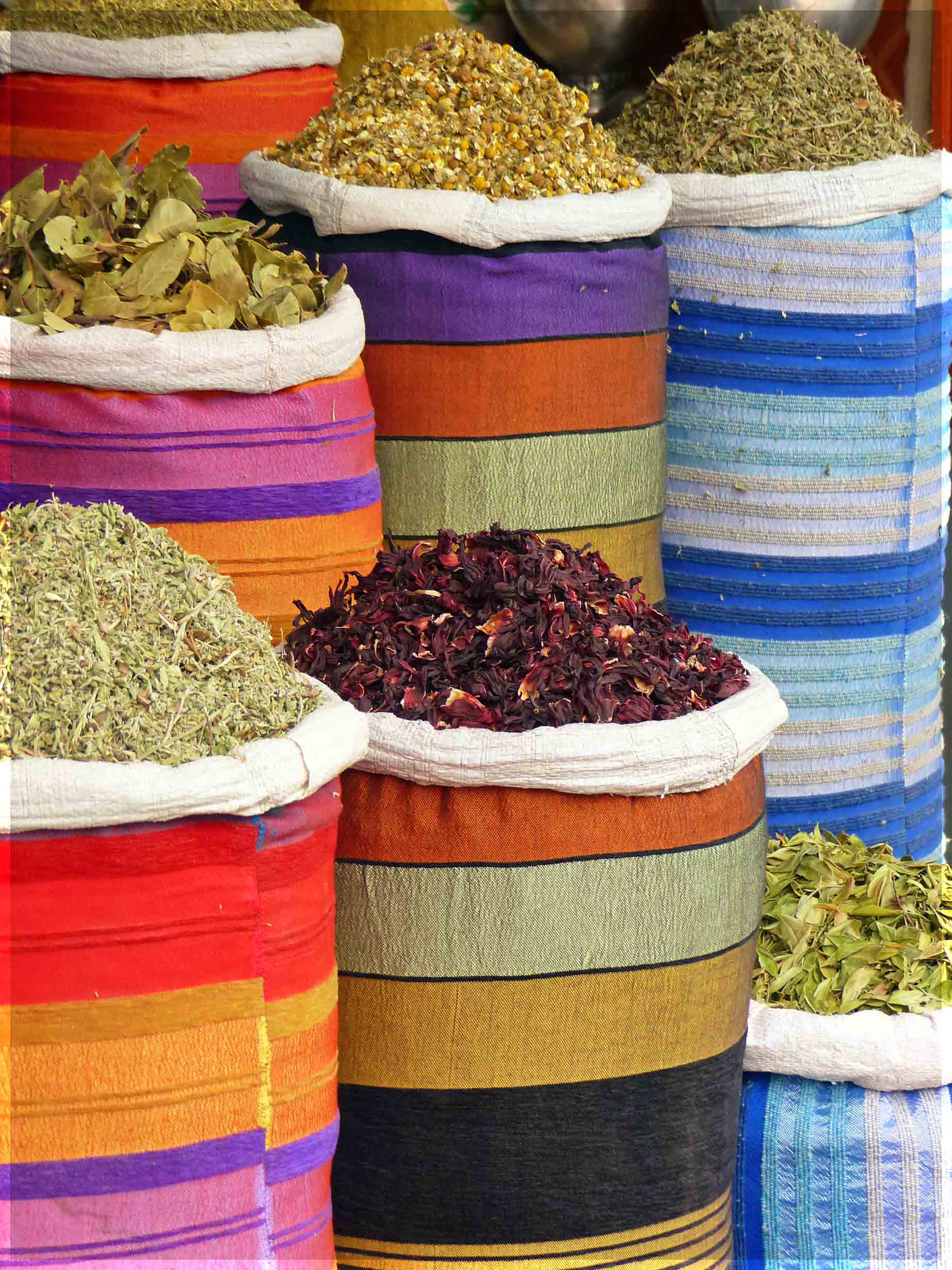 Colourful baskets of herbs and spices
