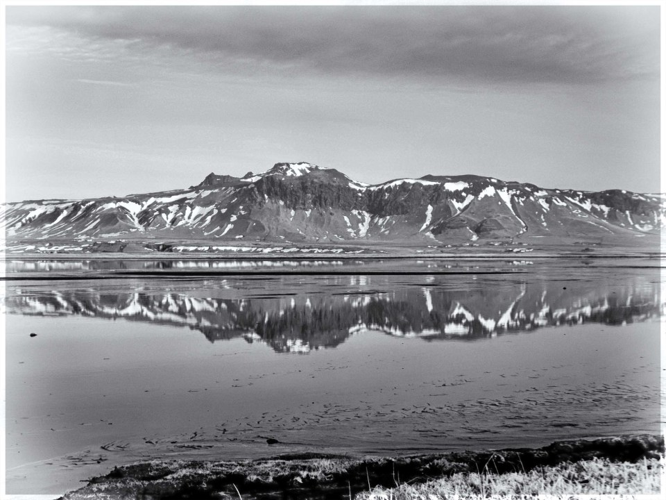 Black and white photo of reflections in a lake