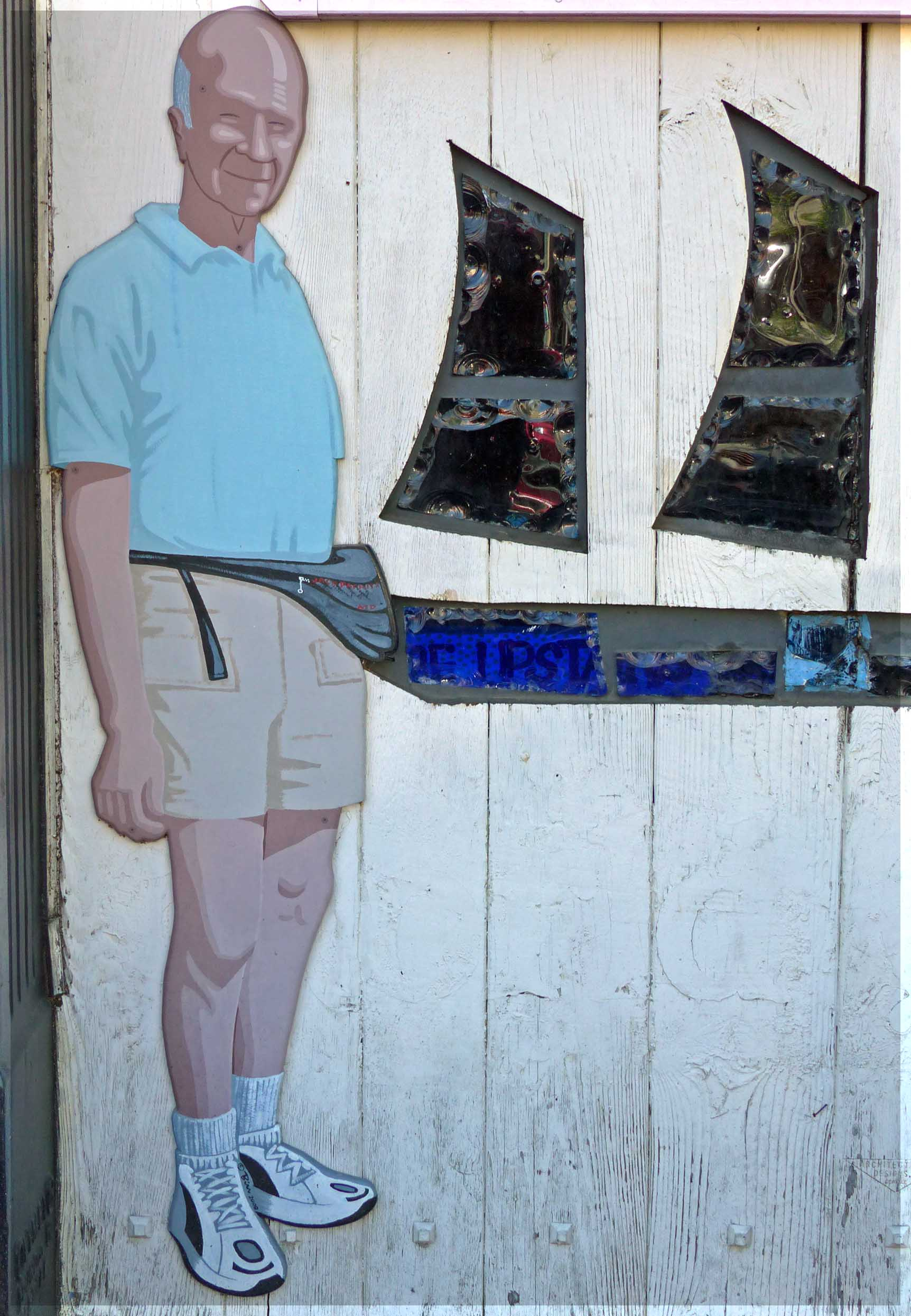Mural of man in shorts and trainers