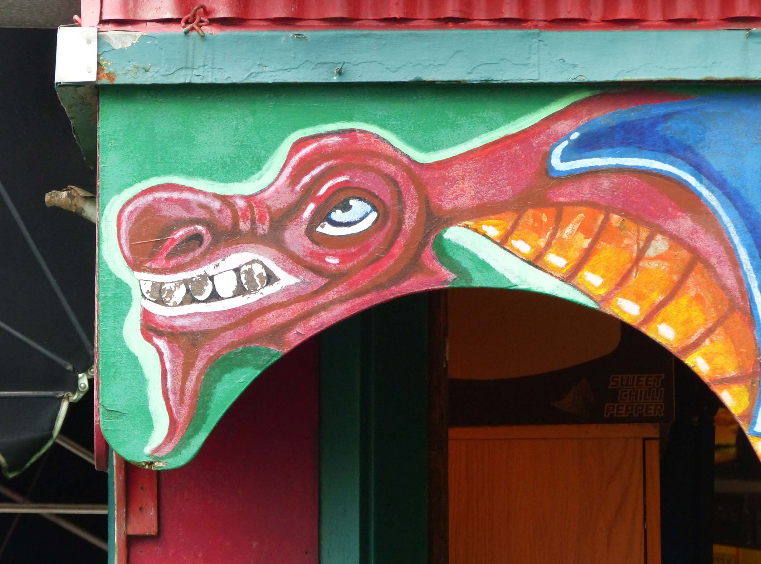 Archway with red dragon painted above