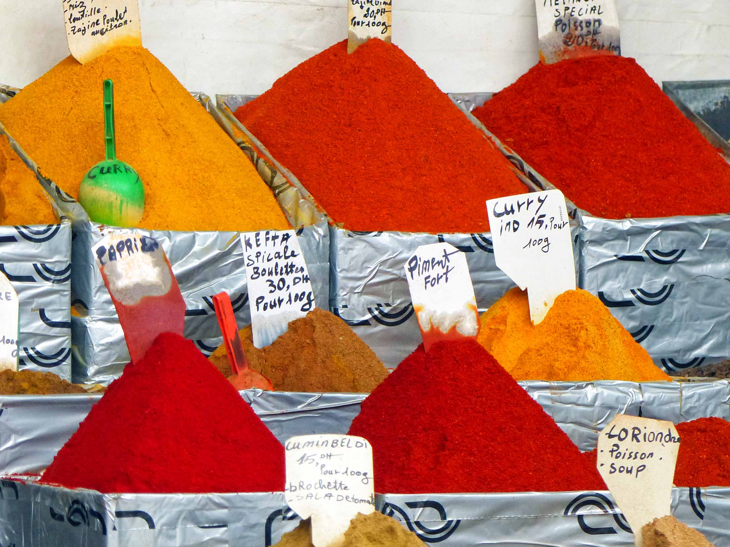 Red and yellow piles of spices