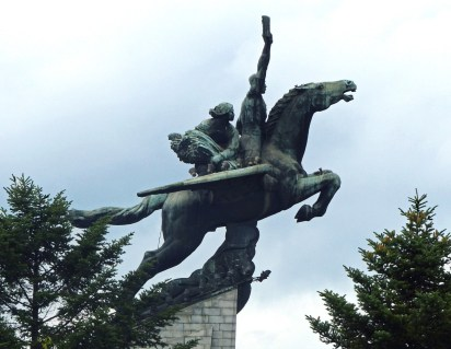 Statue of a flying horse with man and woman on its back