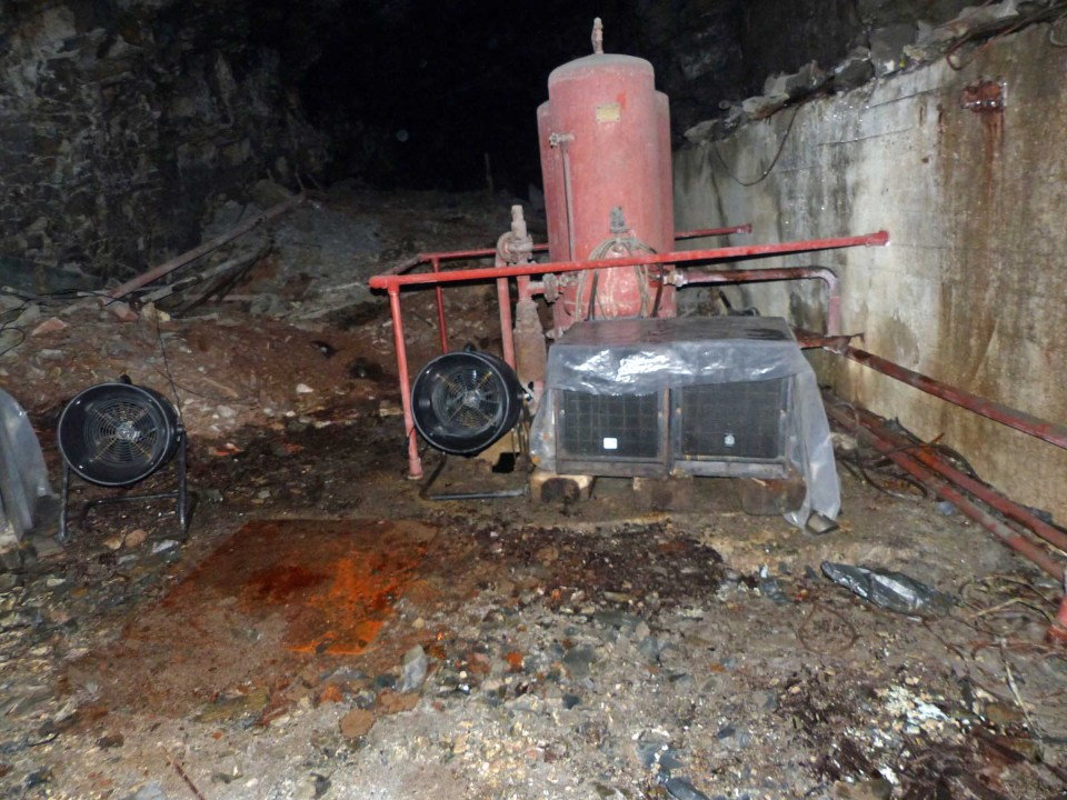 Partly dug tunnel and rusting equipment