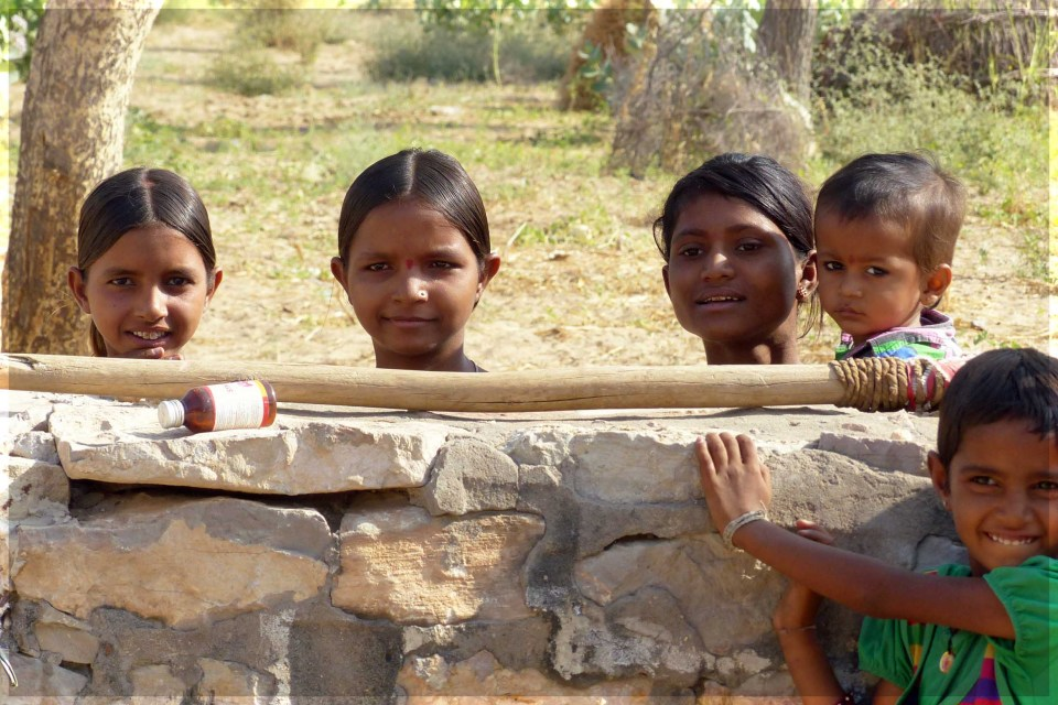 Group of children looking over a wall