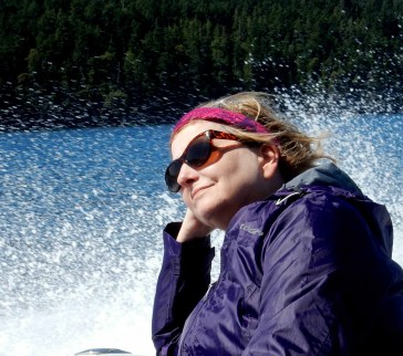 Lady in a boat with spray