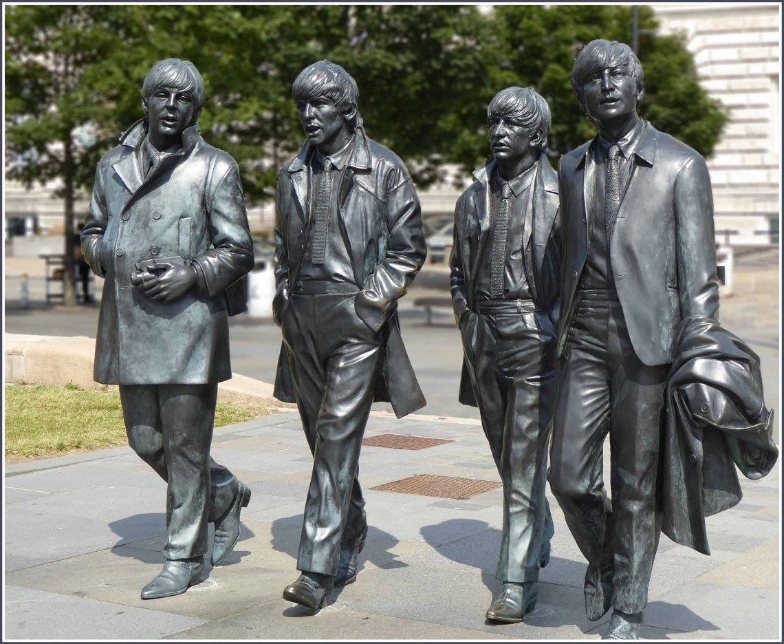 Statues of four young men