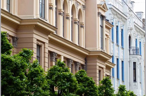Row of elegant buildings in cream, blue and white