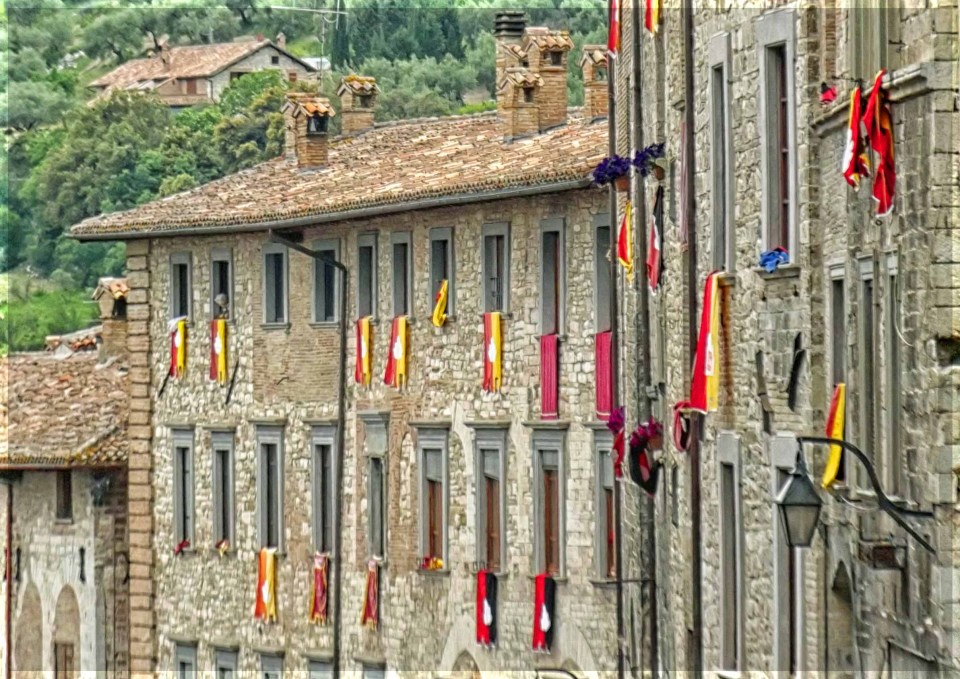 Stone houses with flags draped from windows