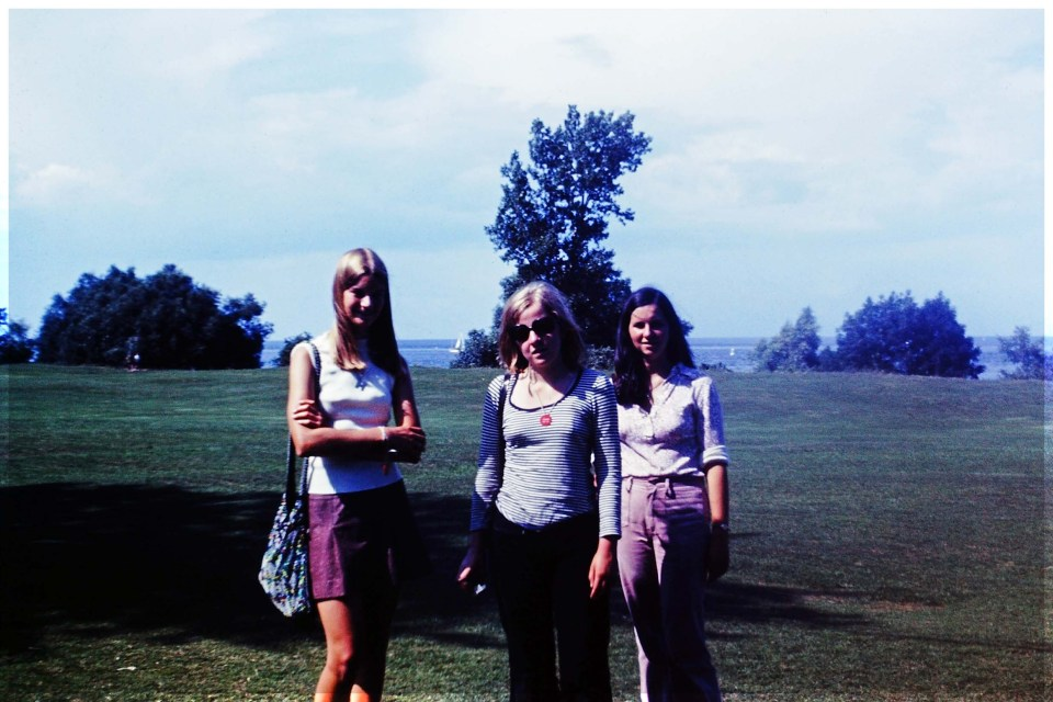 Three teenage girls by a lake