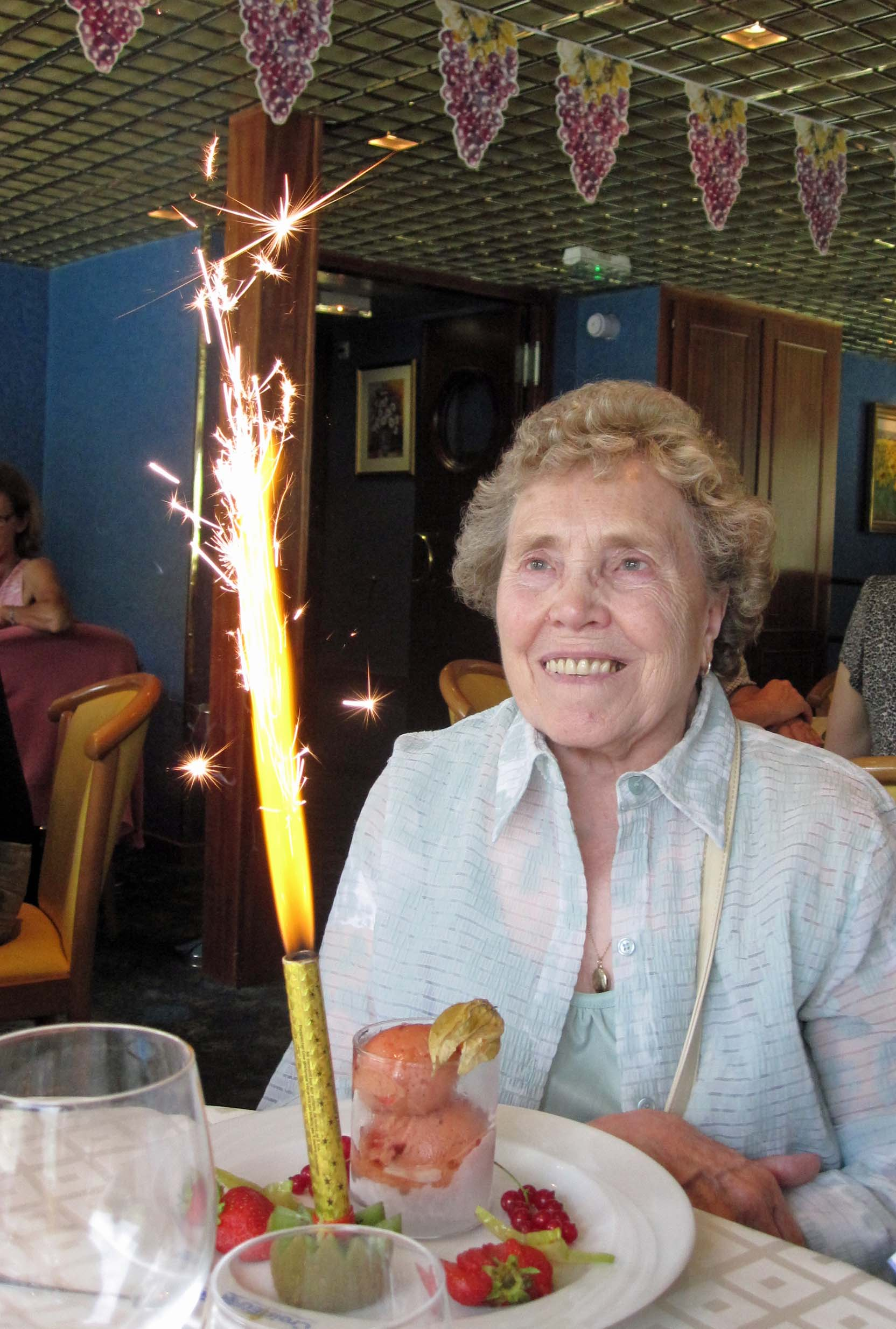Lady with a dessert and sparkler