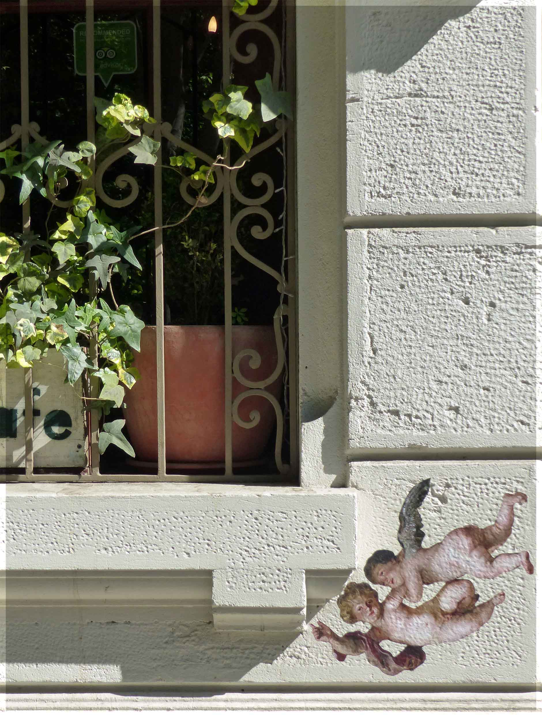 Window and small painting of cherubs