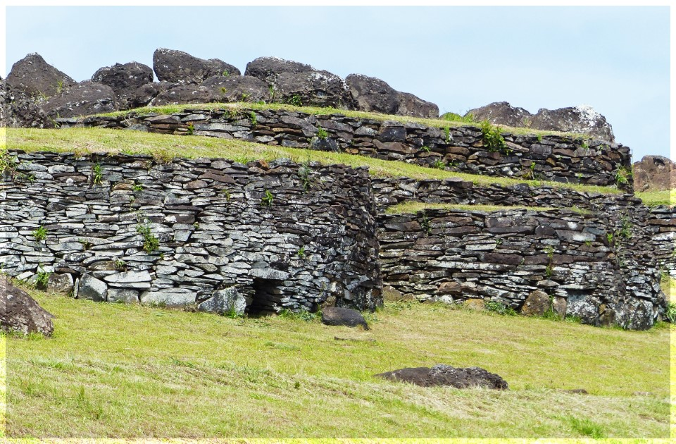 Low stone structures with grassy roofs