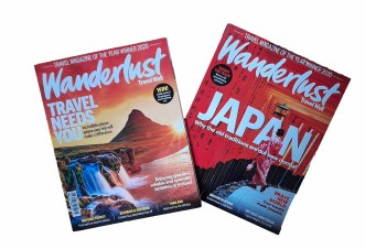 Two travel magazines with bright covers