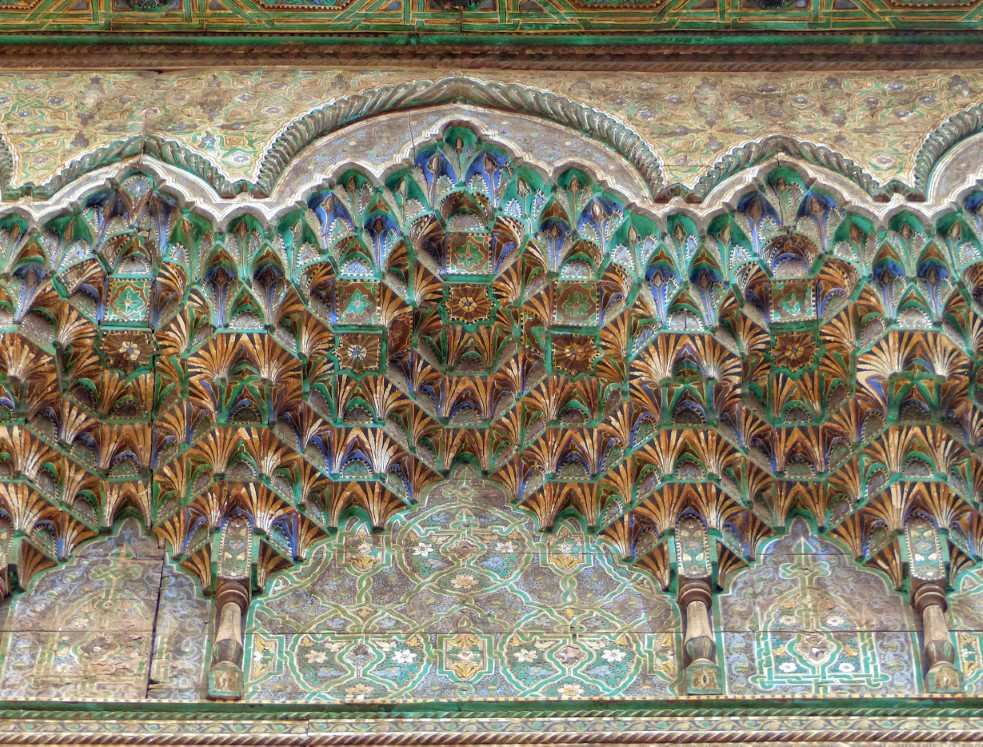 Intricate wall decoration in greens and blues