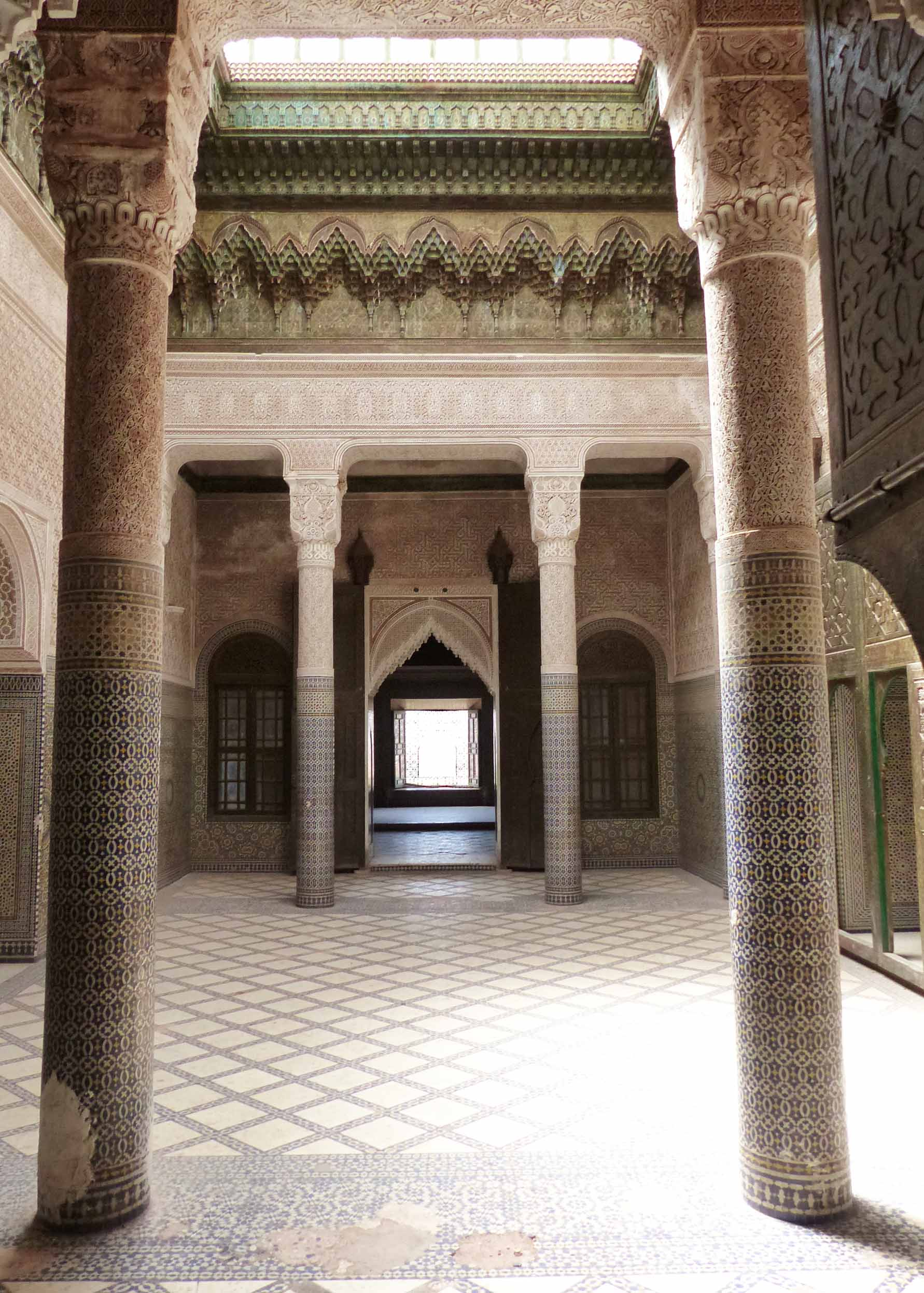 Line of doors leading away, with tiled floor and columns