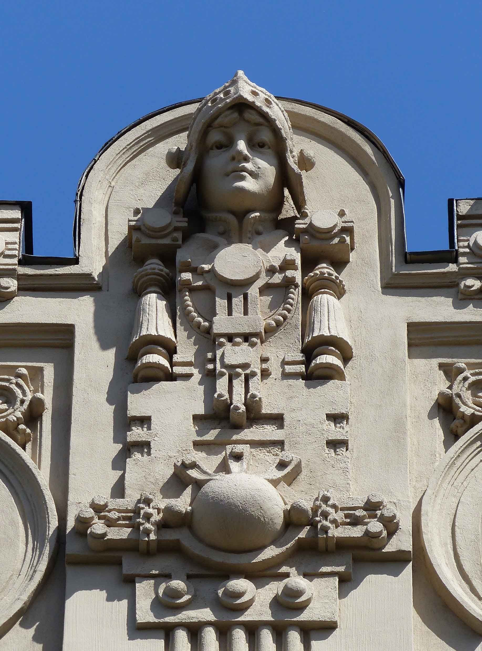 Elaborate carvings at the top of a building