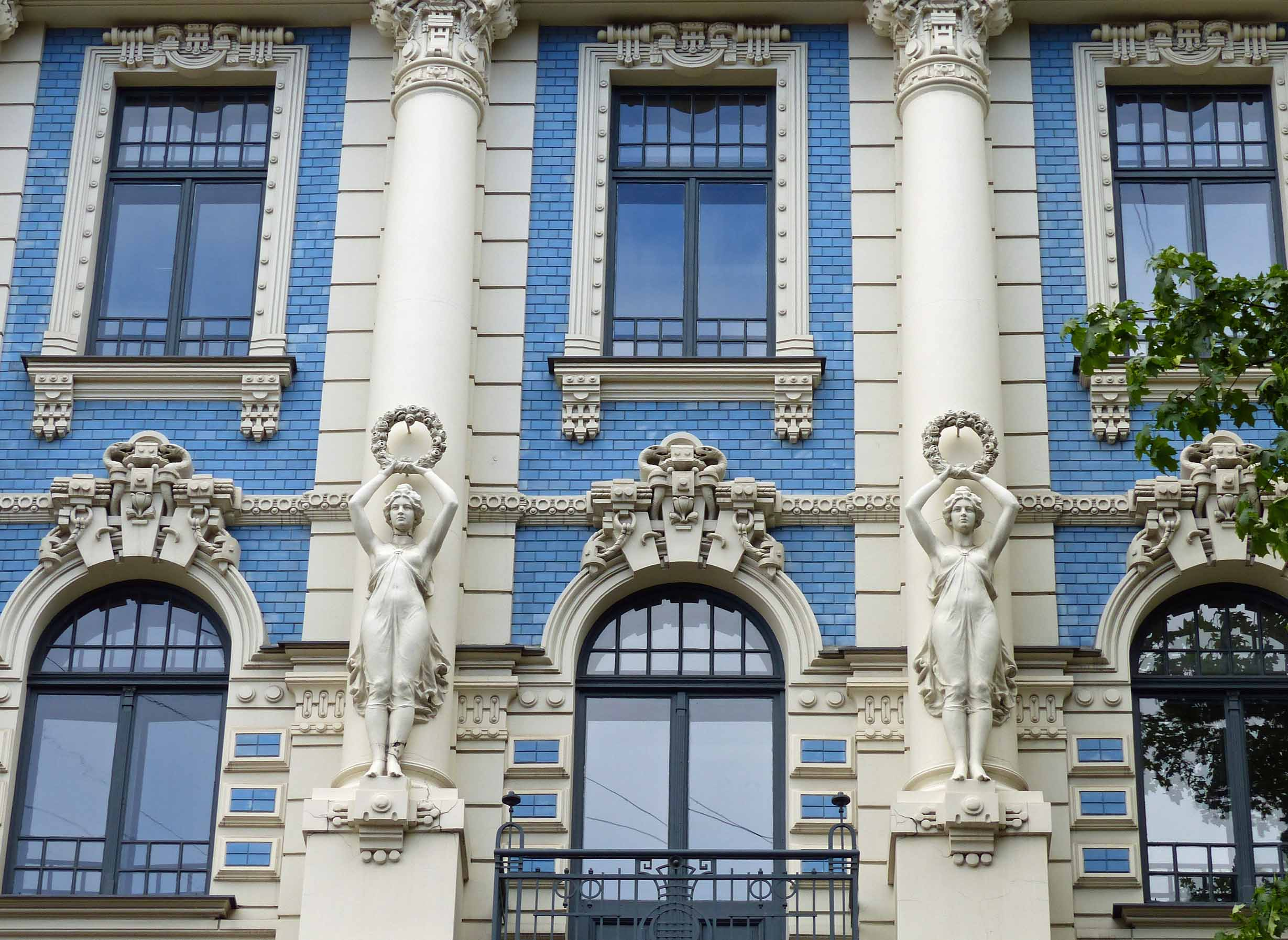 Ornate blue building with white carvings