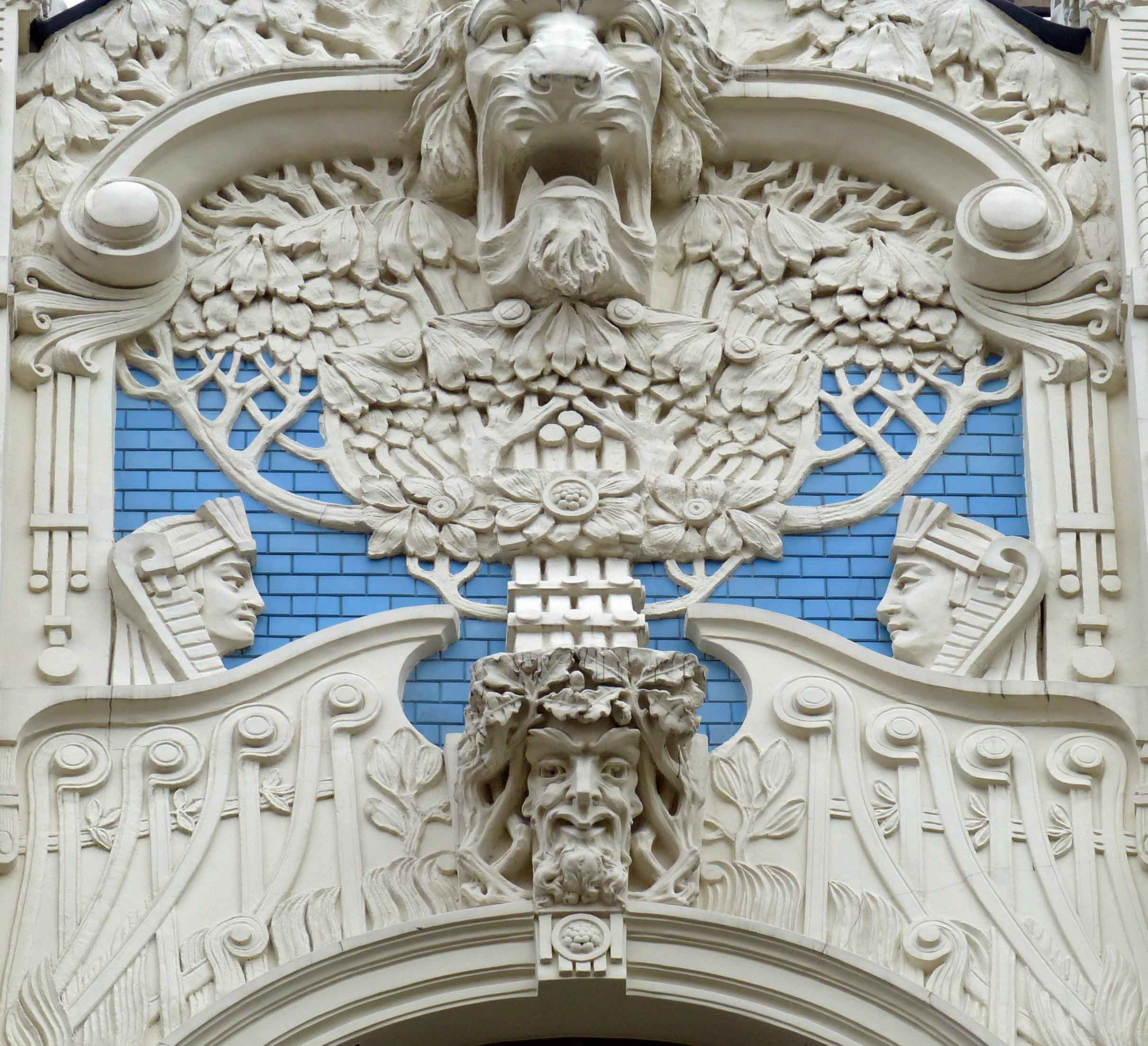 Ornate blue building with details carved in white stone