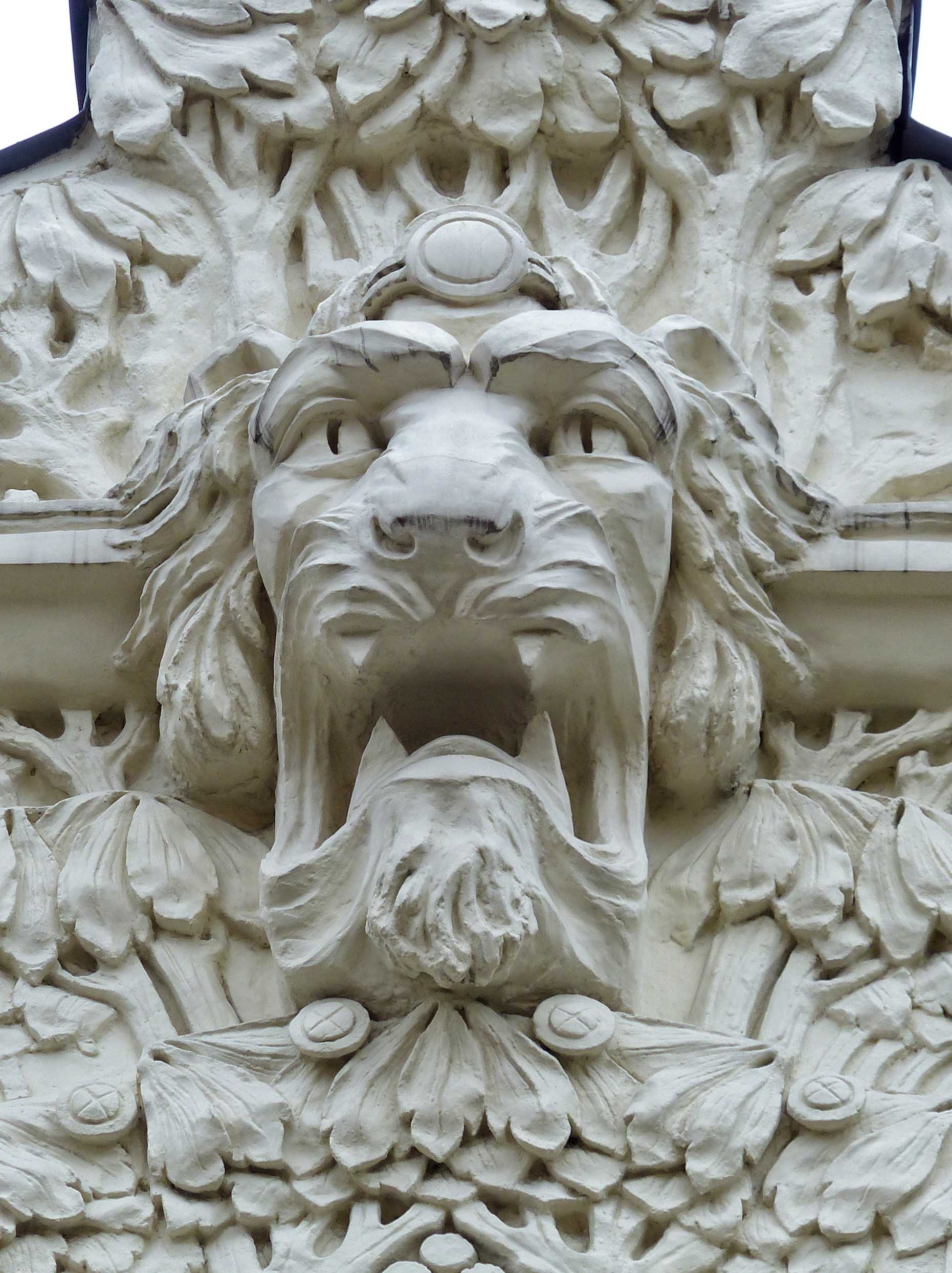 Fierce lion face carved in white stone