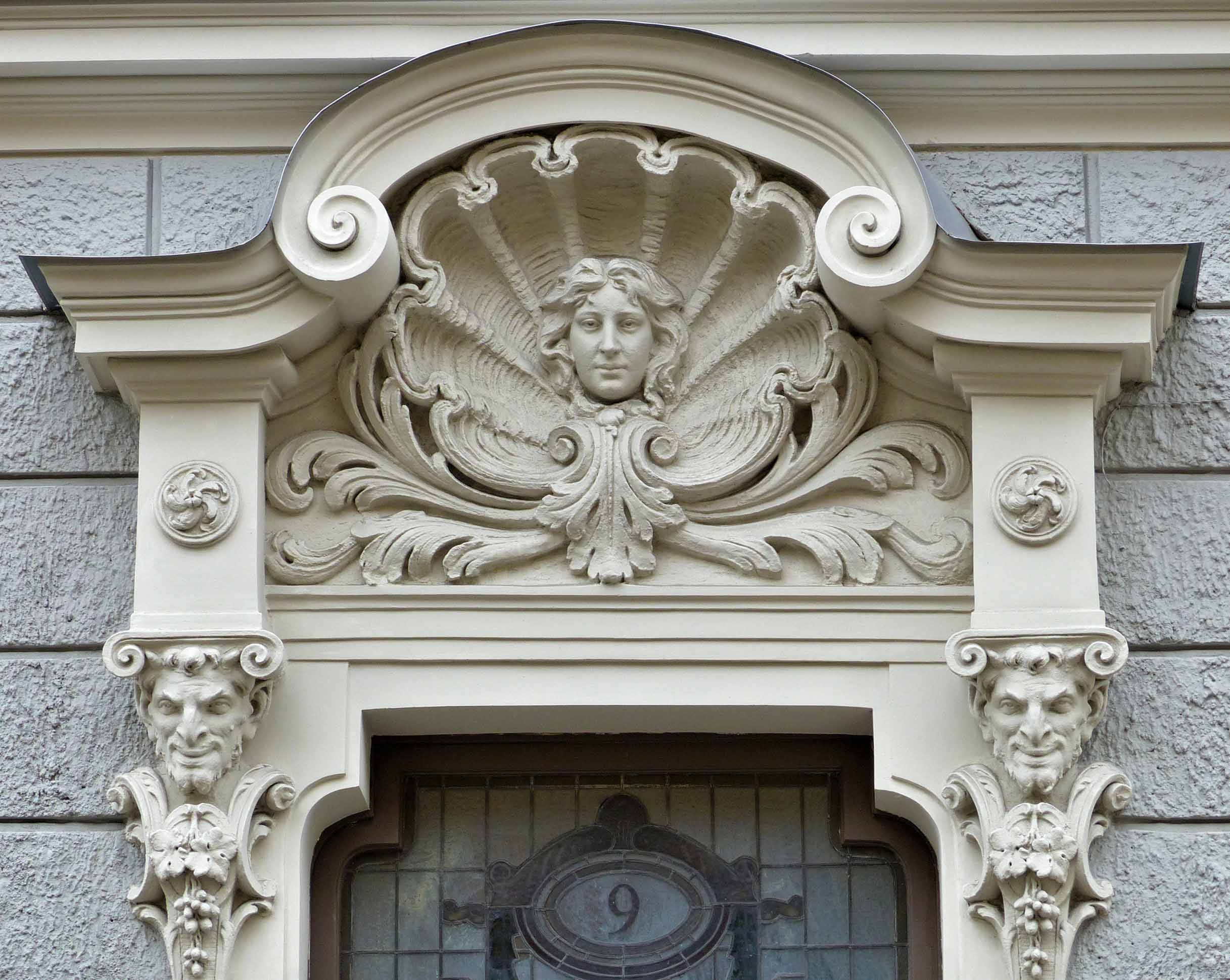 Ornate carving around a door