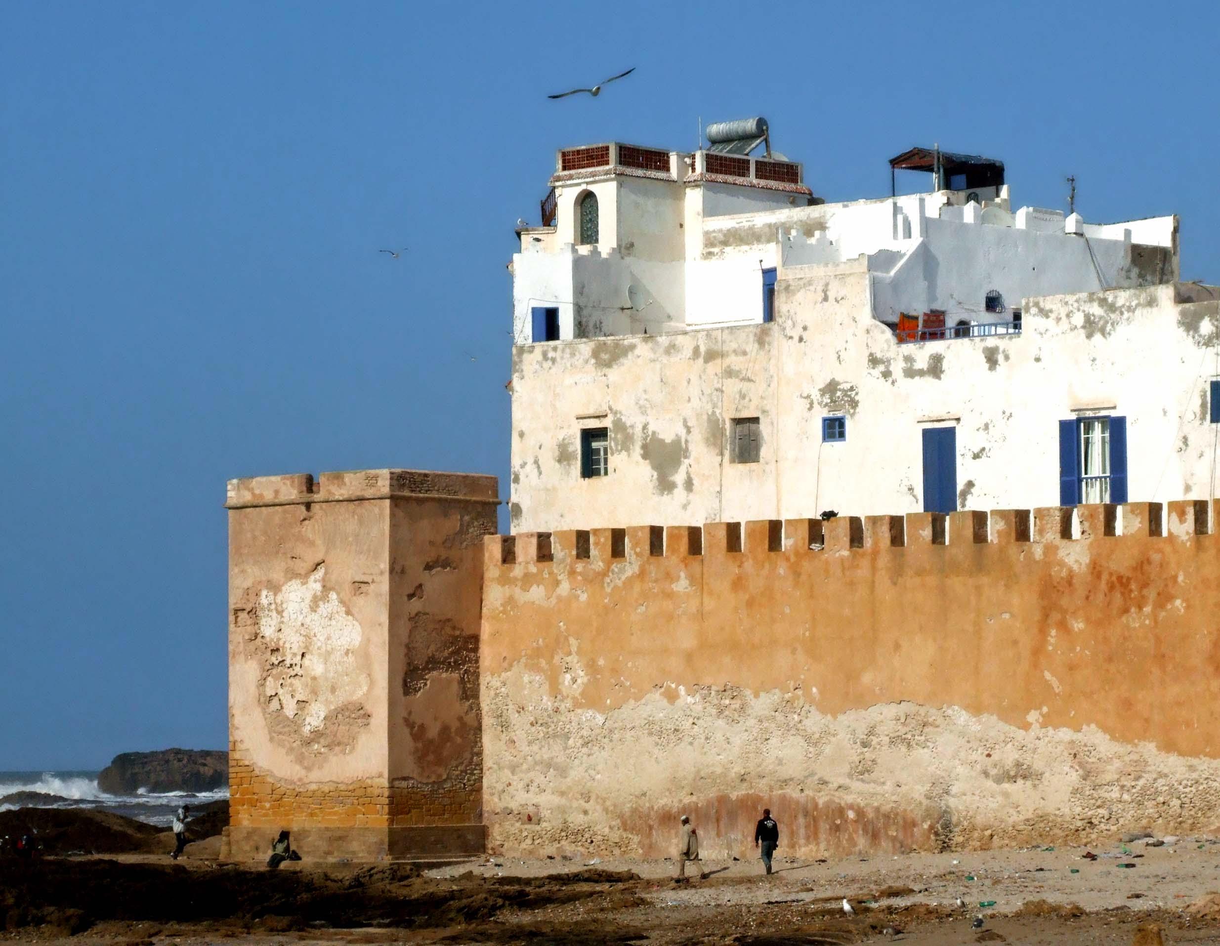 White houses above battlements