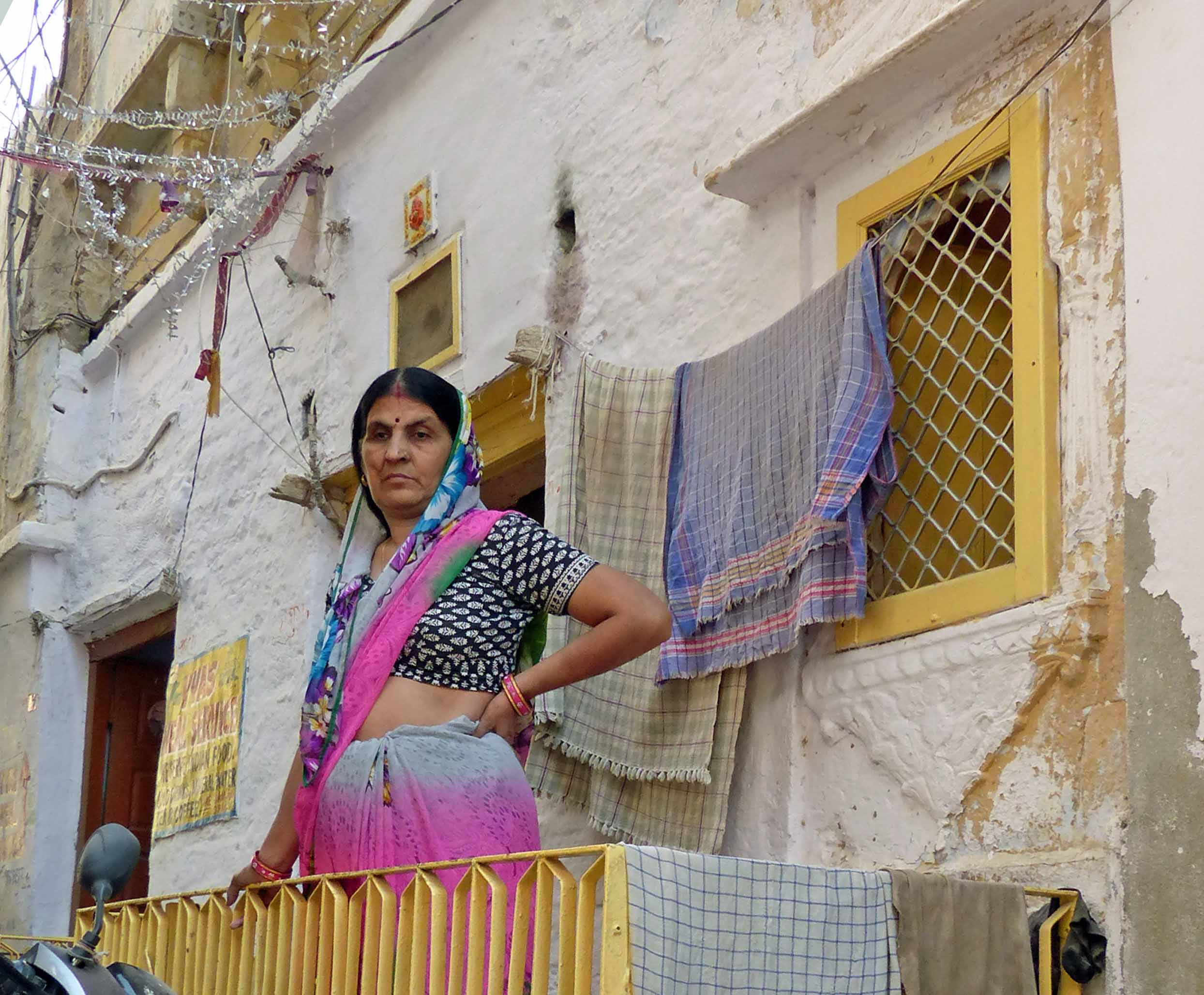 Lady on a balcony with washing drying