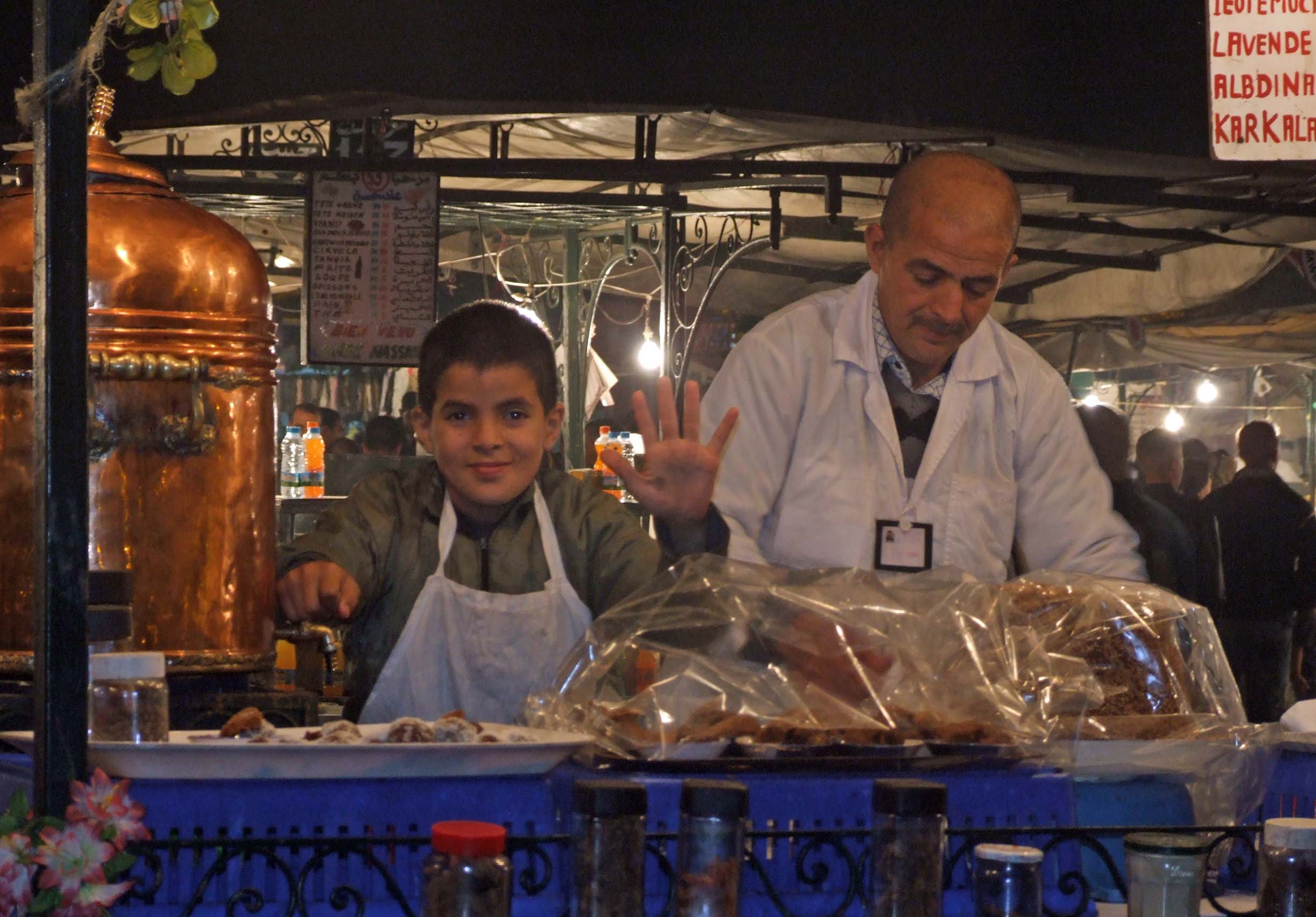 Young boy and man at a food stall