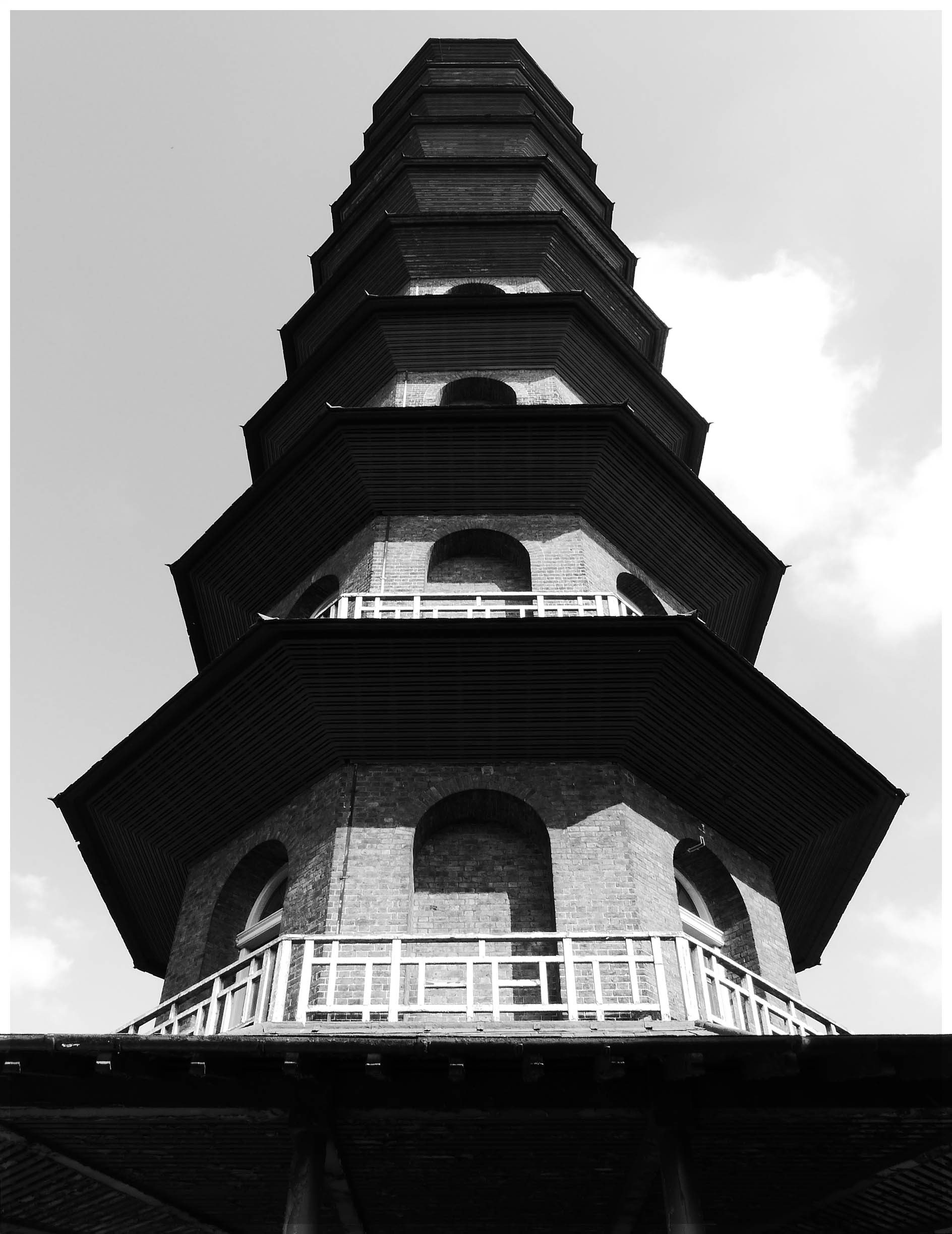 Black and white image of a pagoda seen from below