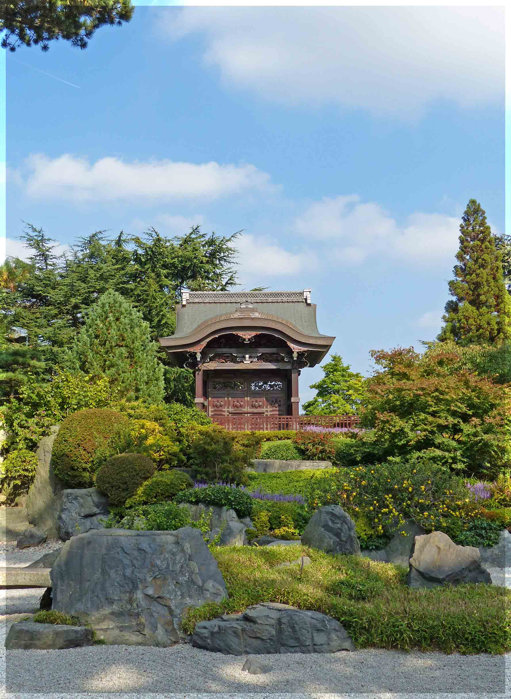 Japanese style garden with rocks, gravel and a small building