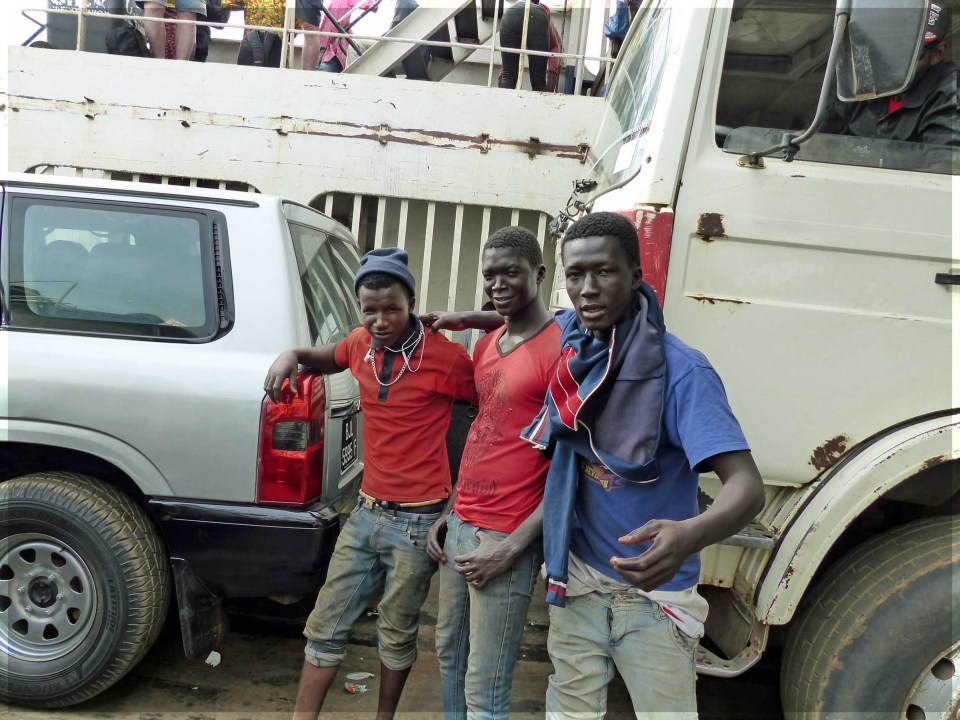 Three young men by a truck