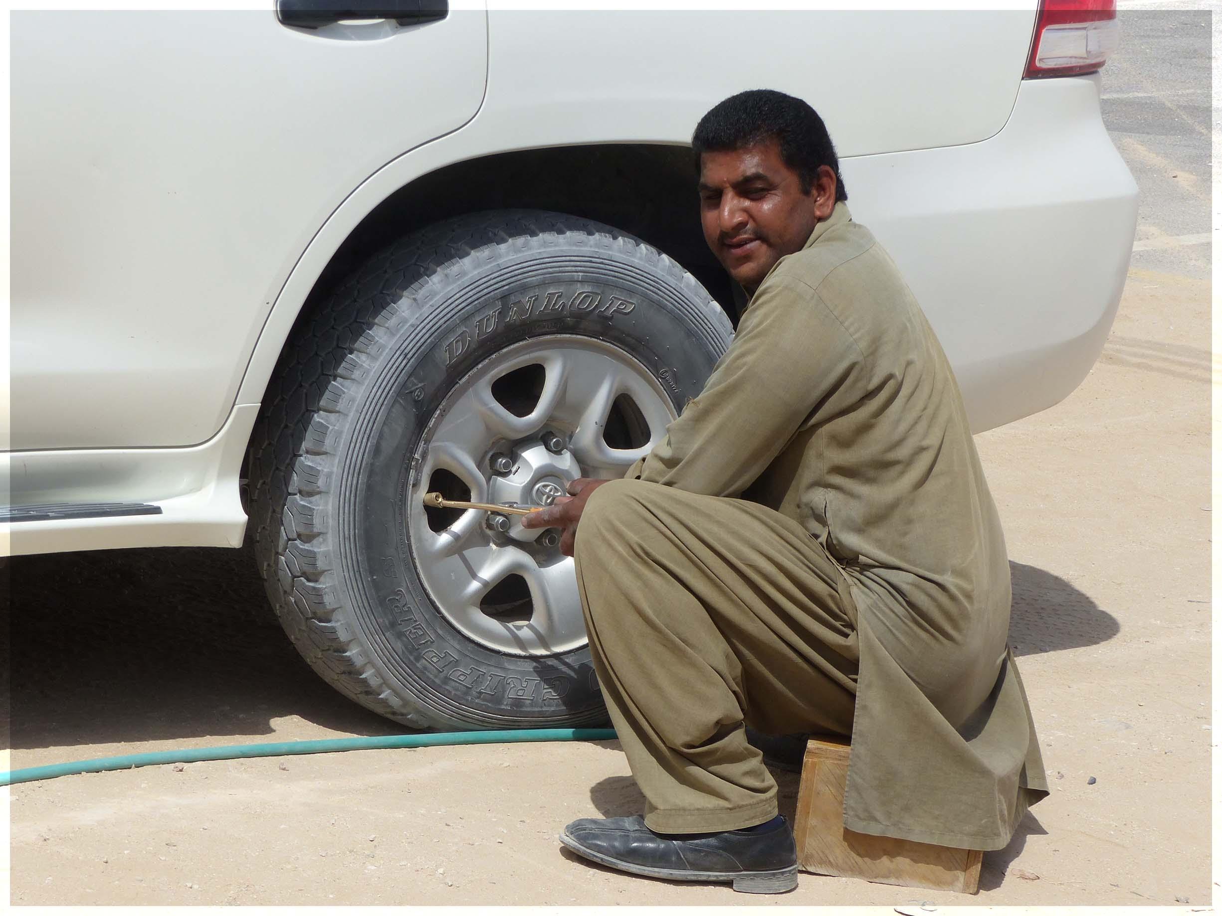 Man pumping up a tyre
