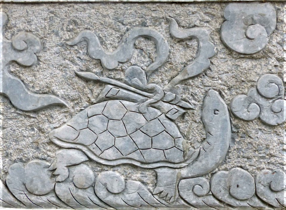 Stone relief carving of a tortoise