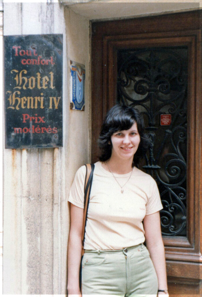 Girl standing by a door with hotel sign