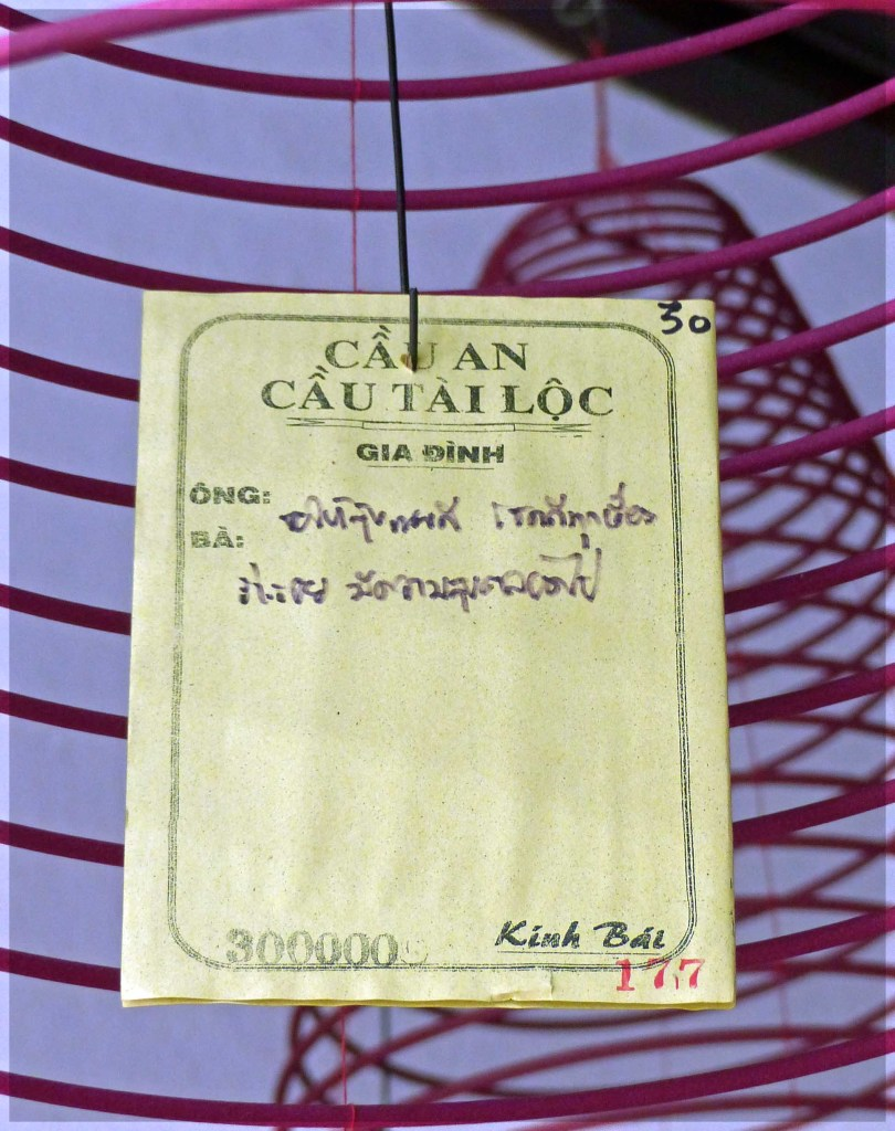 Card with Oriental writing hanging on a string