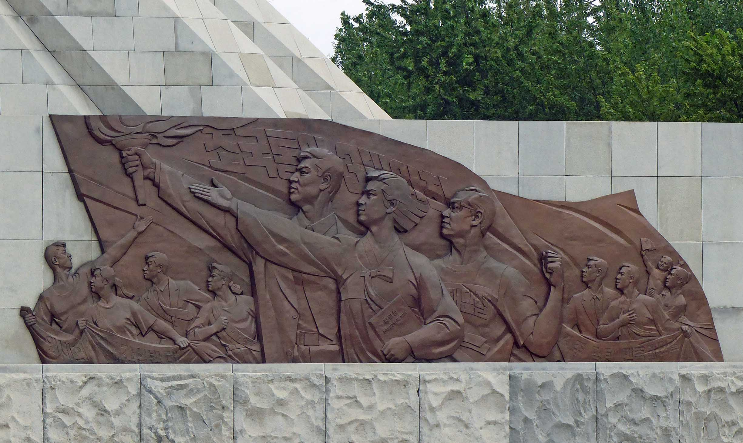 Relief carving of patriotic young people