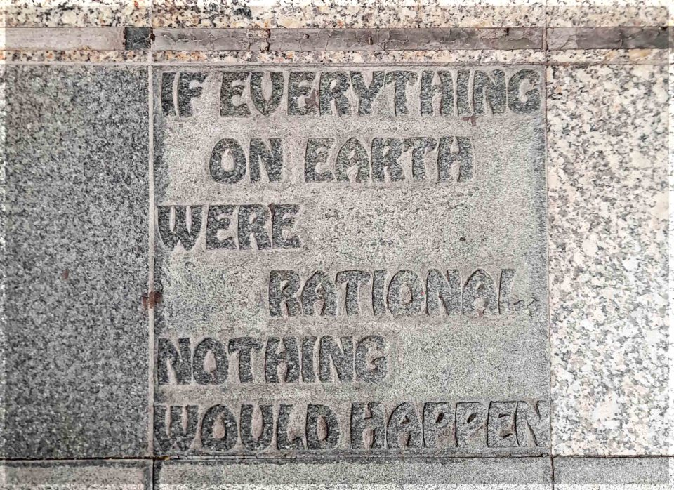 Slogan carved on a paving stone 'If everything on earth were rational, nothing would happen'