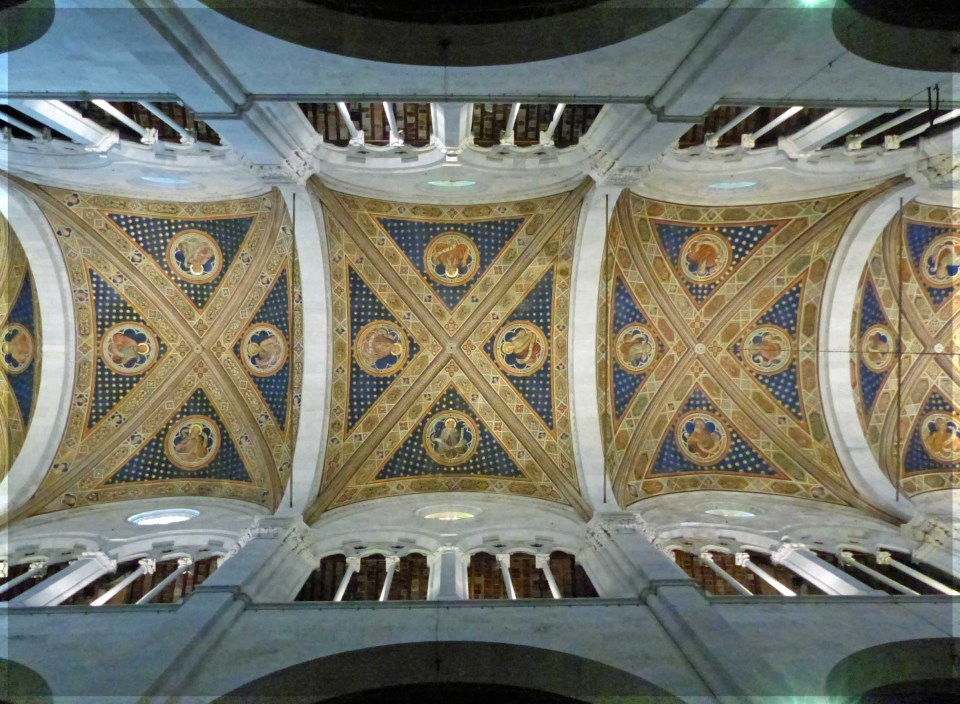 Ornate blue and gold cathedral ceiling with stone pillars