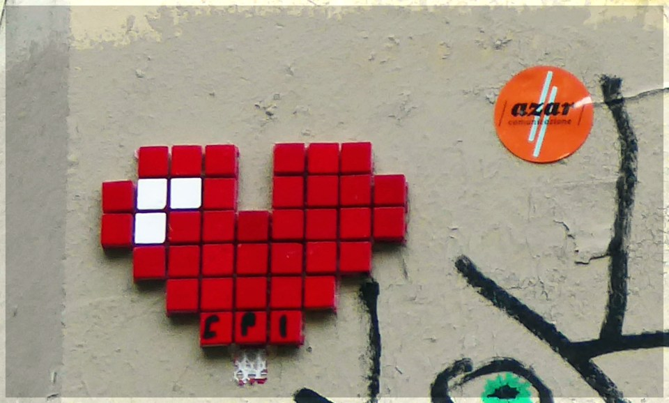 Small heart made from red and white mosaic tiles