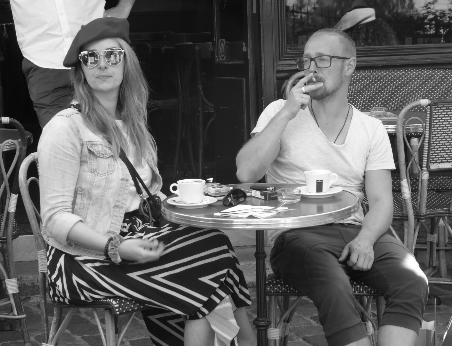 Black and white photo of a couple in a cafe